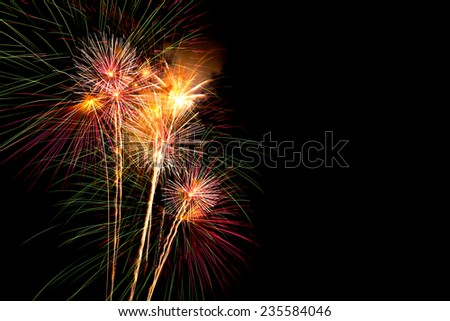 Abstract fireworks on black sky - stock photo