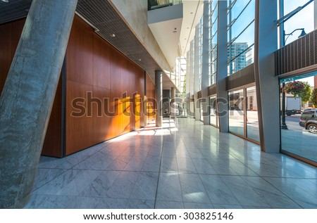 Abstract fragment of the urban architecture of modern luxury building, center, hotel, shopping mall, business centre. Interior design. Vertical. - stock photo
