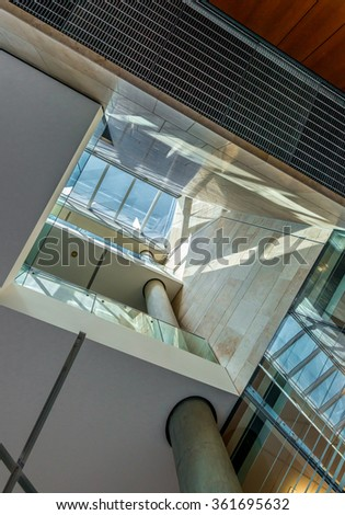 Abstract fragment of the urban architecture of modern luxury building, center, hotel, shopping mall, business center. Interior design. Vertical.
