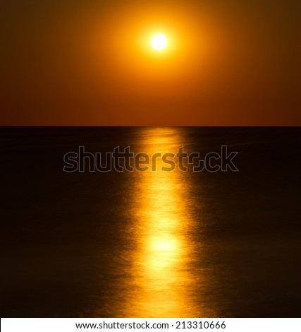 Abstract full moon scene over the sea - stock photo
