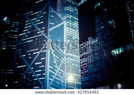 Abstract futuristic night cityscape with illuminated skyscrapers. Hong Kong