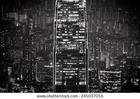 Abstract futuristic night cityscape with illuminated skyscrapers.Hong Kong black and white background - stock photo