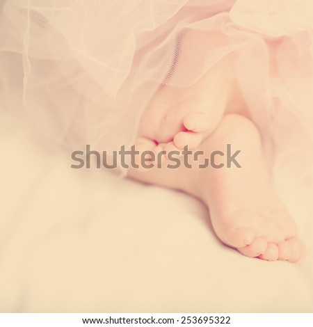 Abstract gentle background with sweet legs a little baby - stock photo