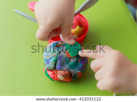 abstract girl playing dough on the table - stock photo