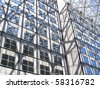 Abstract glass and steel reflection from the outside of an office building - stock