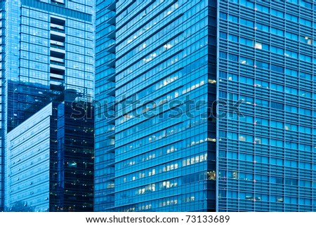 abstract glass skyscrapers at night - stock photo