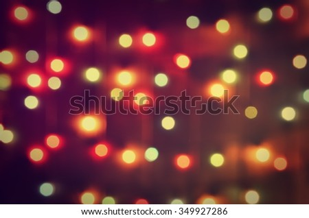 Abstract glowing background. Blurred glowing christmas tree lights.