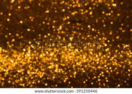 Abstract gold and pink holiday twinkled bright background with natural bokeh defocused lights.