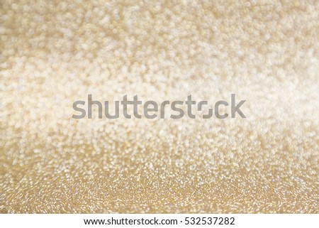 Abstract golden shiny glitter background with copy space