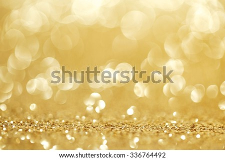 Abstract golden shiny glitter bokeh christmas background - stock photo