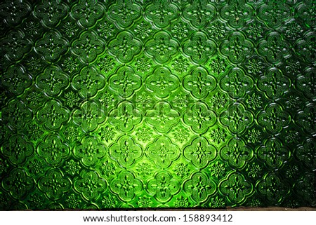 Abstract graphic textured background green glass - stock photo