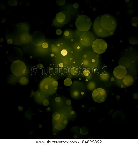 abstract green background, gold bubble lights on black background or snowflakes falling at night. Bokeh Christmas background with circle designs or blurred stars shining, glitter magic background