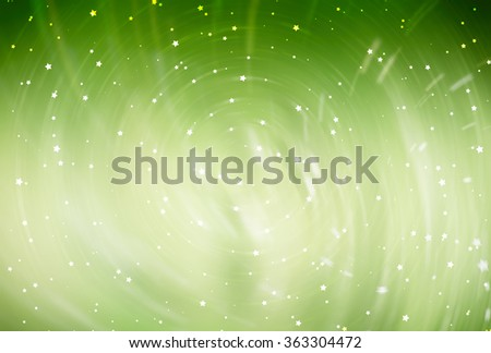 abstract green background with scintillating circles and gloss