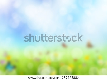 Abstract green blur background of spring meadow with butterflies - stock photo
