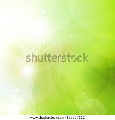 Abstract green blurry background with overlying semitransparent circles, light effects and sun burst. Great spring or green environmental background. Space for your text. - stock photo