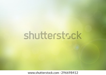 Abstract green nature blurred background with bright sunlight, flare and bokeh effect, use for backdrop or web design in environment concept - stock photo
