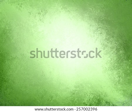 abstract green paper background, white center and vintage paper layout with burnt edges or grunge border design, aged distressed texture and stains - stock photo