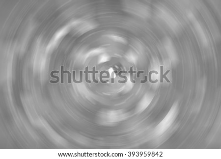 abstract grey background with scintillating circles and gloss