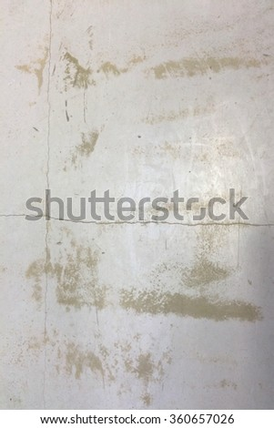 Abstract grunge texture with scratches and a piece of paint. Grey and beige street wall background. Grunge texture perfect for aged effect. Old dirty texture for your design - stock photo