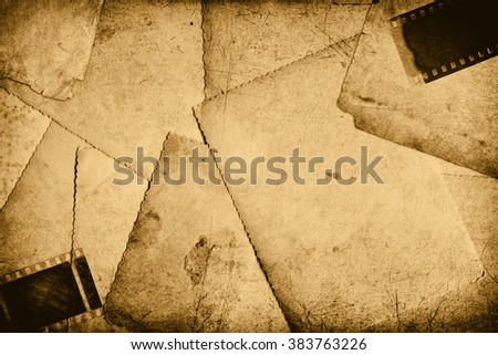 Abstract grungy background - old brown photo paper sheets, scratched filmstrip - stock photo
