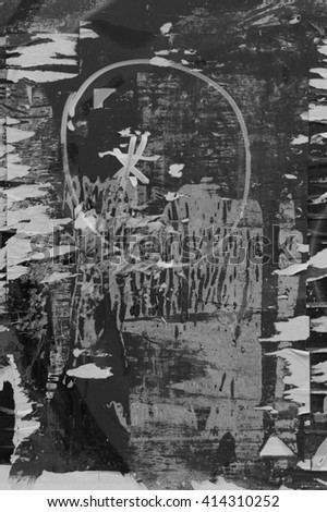 Abstract grungy background with torn posters and paint stains. Black and white.