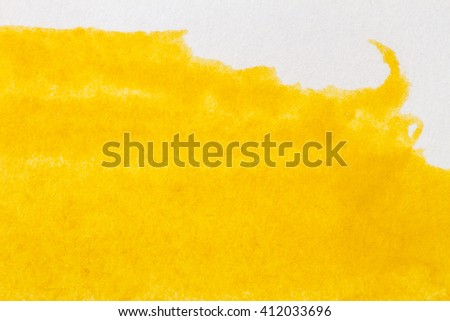 Abstract hand drawn yellow watercolor paints background