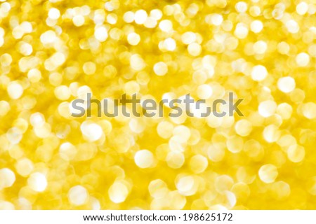 Abstract holidays golden lights on background - stock photo