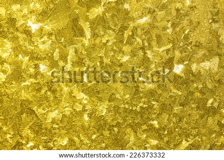 abstract holidays shiny gold  yellow background from a frosty pattern on glass - stock photo
