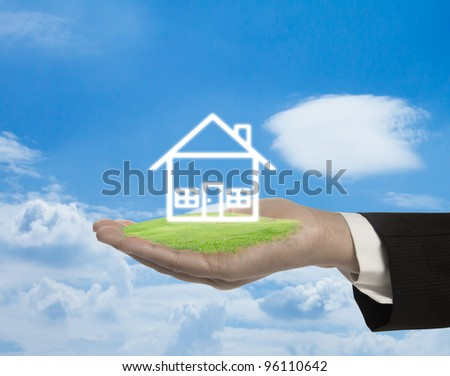 Abstract house on the hand. - stock photo