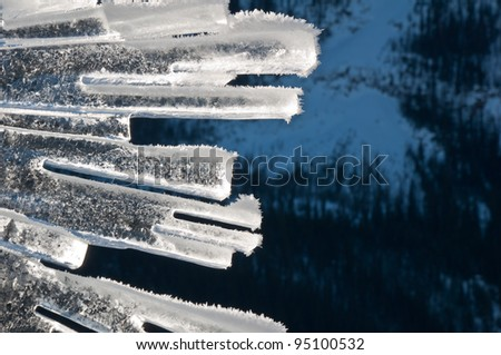 Abstract ice sculpture on a sunny winter day in the mountains - stock photo