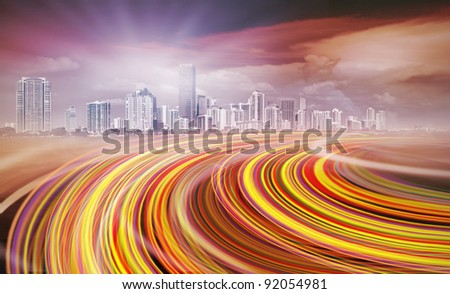 Abstract Illustration of an urban highway going to the modern city downtown at sunset or sunrise with colorful light trails. - stock photo