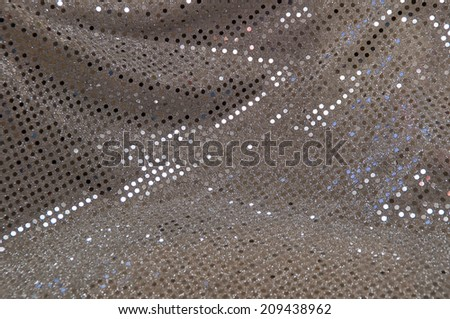 Abstract image of a silver grey sequined piece of fabric typically used to make dancer's costumes or dresses. - stock photo