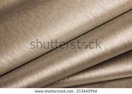 Abstract image of beige paper rolls - stock photo