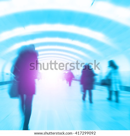 Abstract image of blurred people walking in subway station. - stock photo