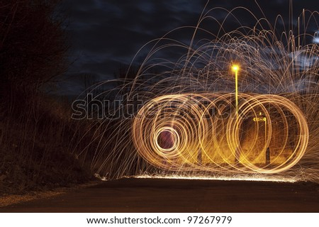 Abstract Image of Burning Wirewool being used to make spiral like light trails at Night