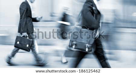 abstract image of business people in the street and modern style with a blurred background and blue tonality - stock photo