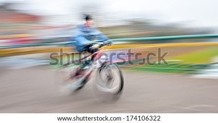 Abstract image of cyclist on the city roadway. Intentional motion blur - stock photo
