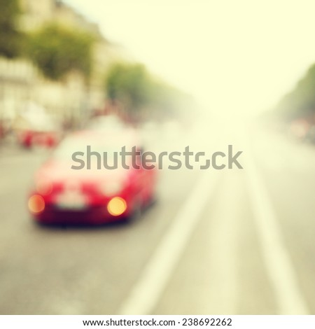 Abstract image of defocused car on the road. - stock photo