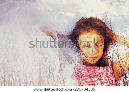 abstract image of Double exposure of tree brunches in the autumn and cute happy kid dreaming  - stock photo