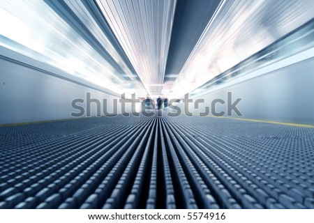 abstract image of escalator in motion - stock photo