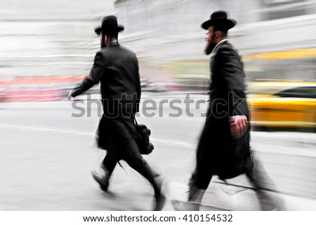abstract image of jewish business people in the street - stock photo