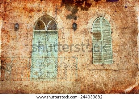 abstract image of old house's wall from jerusalem stone with old blue balcony. filtered and textured image  - stock photo