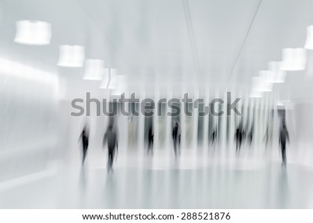 abstract image of people in the lobby of a modern business center with a blurred background - stock photo