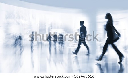 abstract image of people in the lobby of a modern business center with a blurred background  and a blue tonality - stock photo