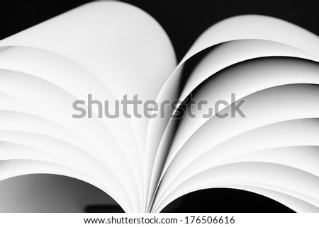 Abstract image of sheets white paper wave shape on black background close-up - stock photo
