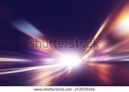Abstract image of speed motion on the road at night time. - stock photo