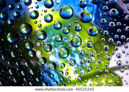 Abstract image of the planets from the bubbles of water - stock photo