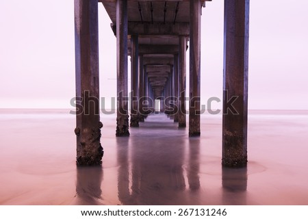 Abstract landscape of under a bridge and water - stock photo