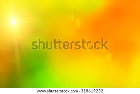 Abstract leaf fall  background with sun beams and flares - stock photo