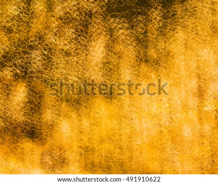 Abstract Light Painting with the camera movement of golden background